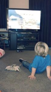 Ron's son Jayden watching his dad's VHS.
