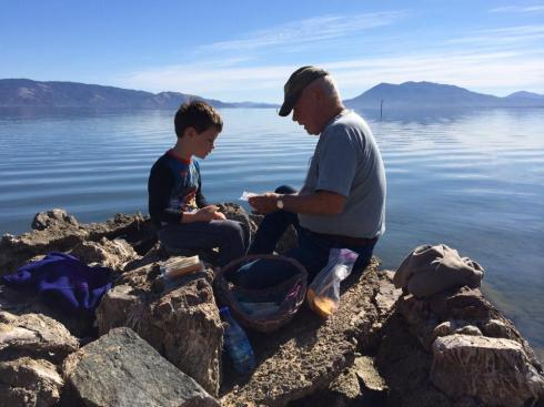 Episode V and Grandpa having a picnic on the rocks.